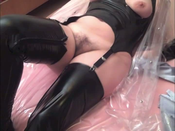 Crossdresser playing with wife in plastic and tube