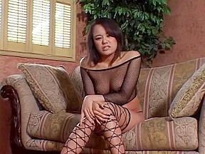 Taut Asian in fishnets takes deep drilling on sofa