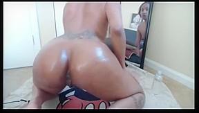 Ebony ladyboy takes dick