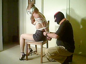Pretty Redhead In Tight Tape Bondage
