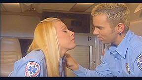 Uniformed playgirl fucking in the back of an ambulance