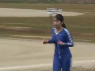 Japanese girl runs track in bodypaint