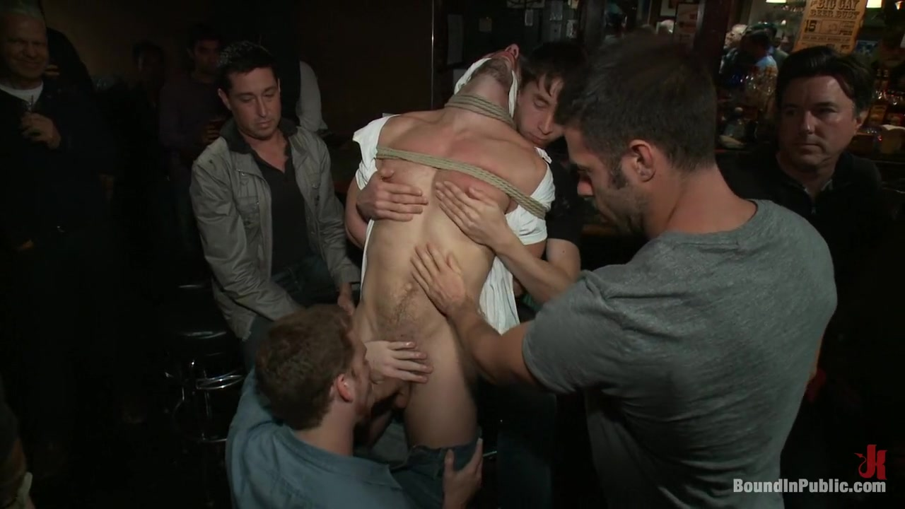 Naked ripped stud gets humiliated and used in a crowded public bar.
