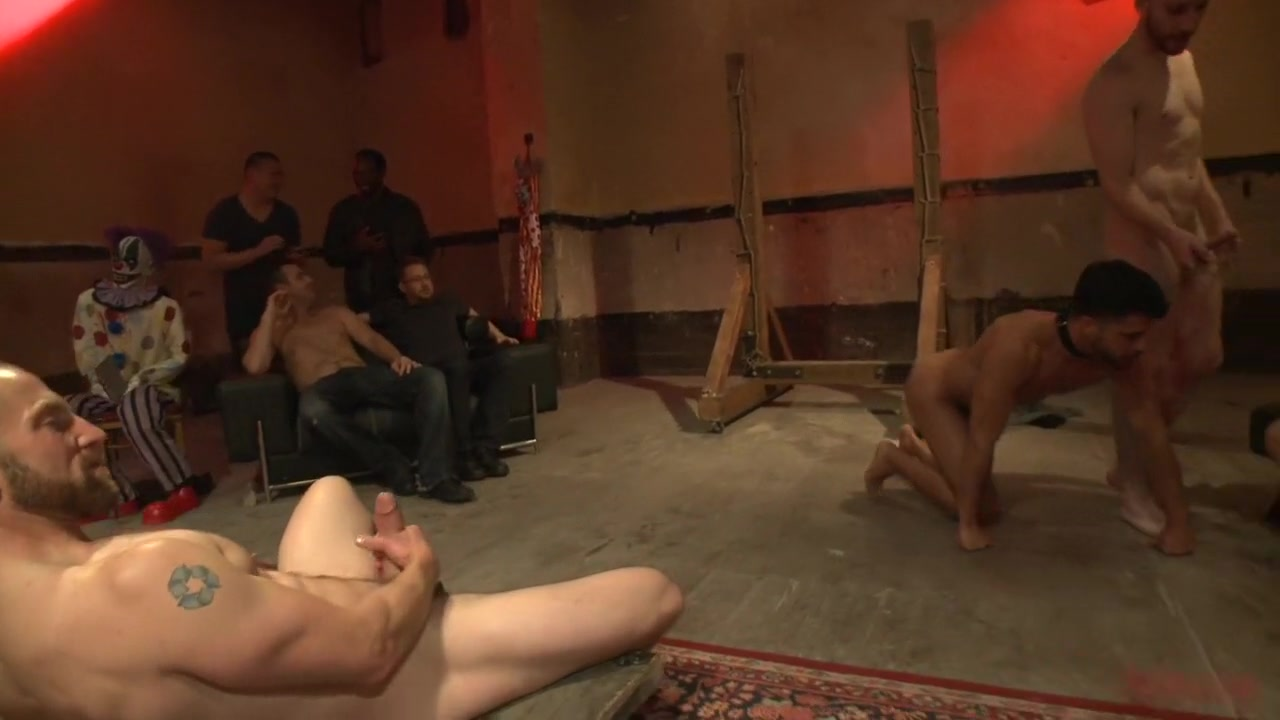 Bound hunk with an uncut cock gets gangfucked by a crowd of horny men