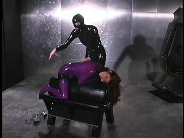 Latex Mistress Fucks Her Slave With Toy
