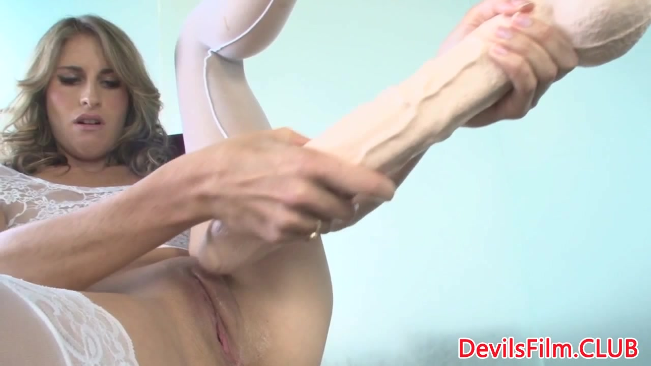 Dildo loving beauty riding a big one