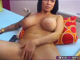 Big tit brunette milf plays with her huge tits on webcam