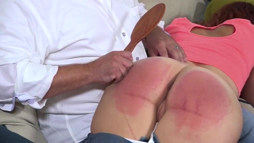 Red haired girl spanked