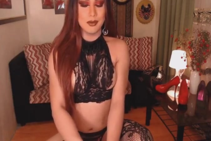 busty redhead tranny loves playing her big cock