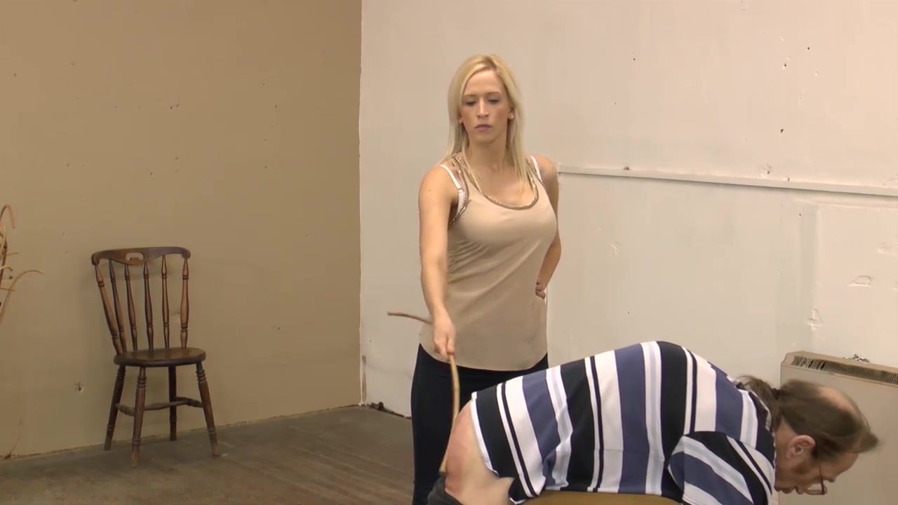 slave bends over and gets belted and caned by strict blonde dominatrix