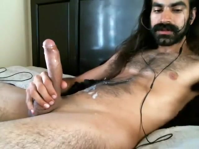 hairy long haired guy shooting his nut on his chest
