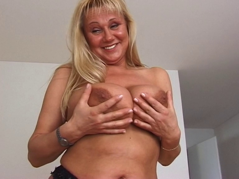 kinky mature babe with big tits trying different cloth